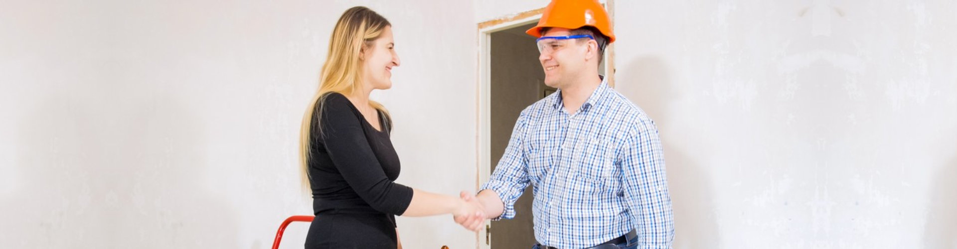 businesswoman and foreman engineer shaking their hands